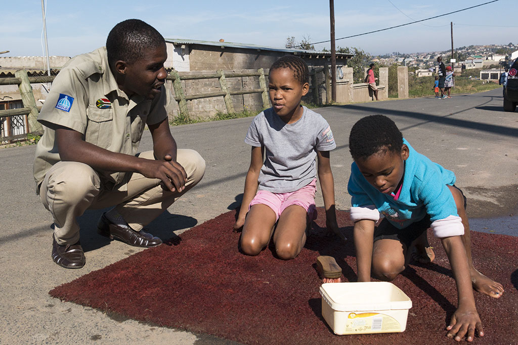 Sanele interacting with some children