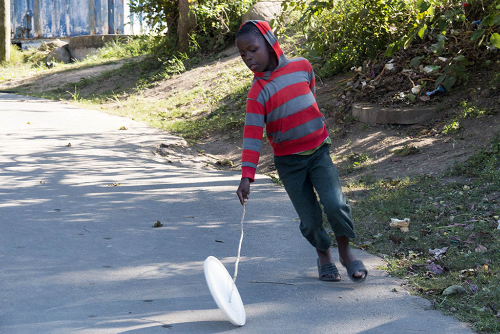 Child playing in the road