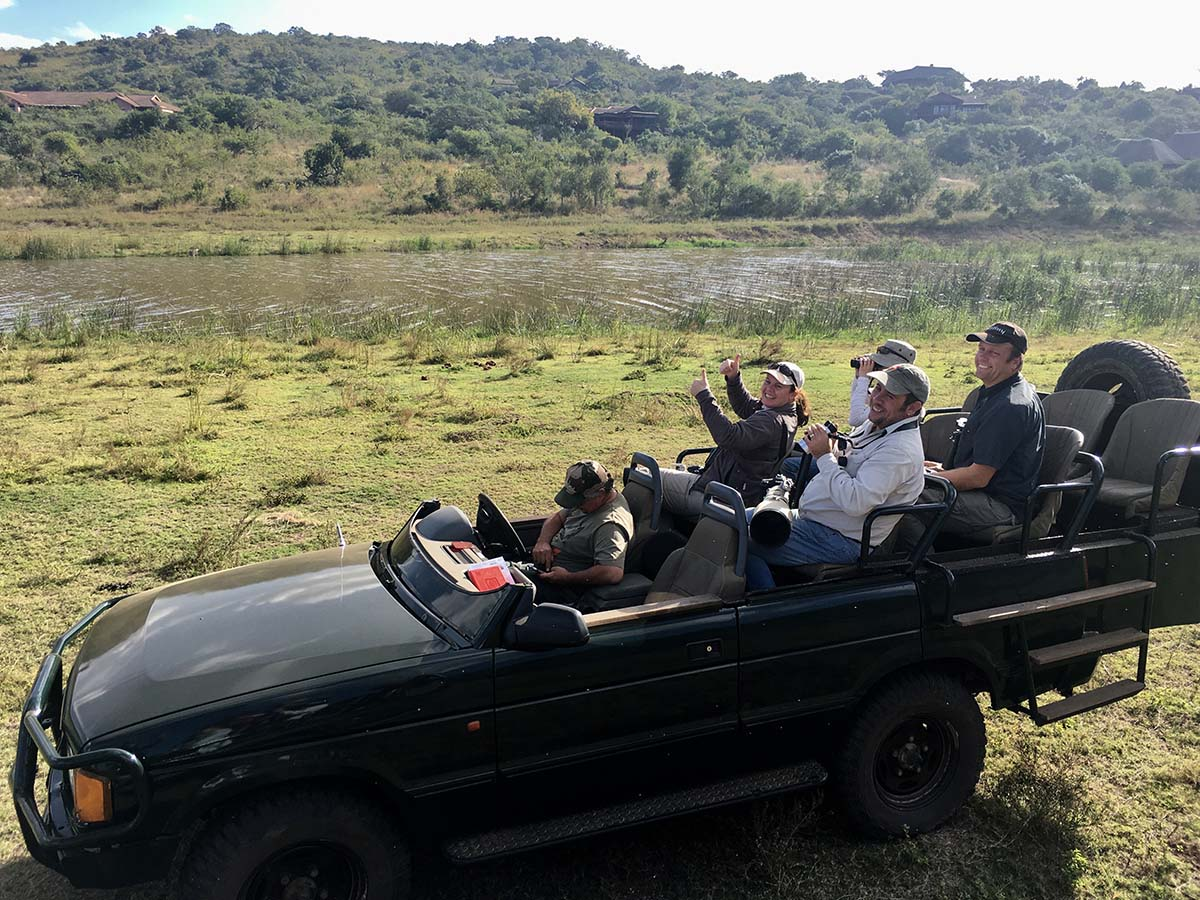 A group of happy birdwatchers after connecting with the Malagasy Pond Heron