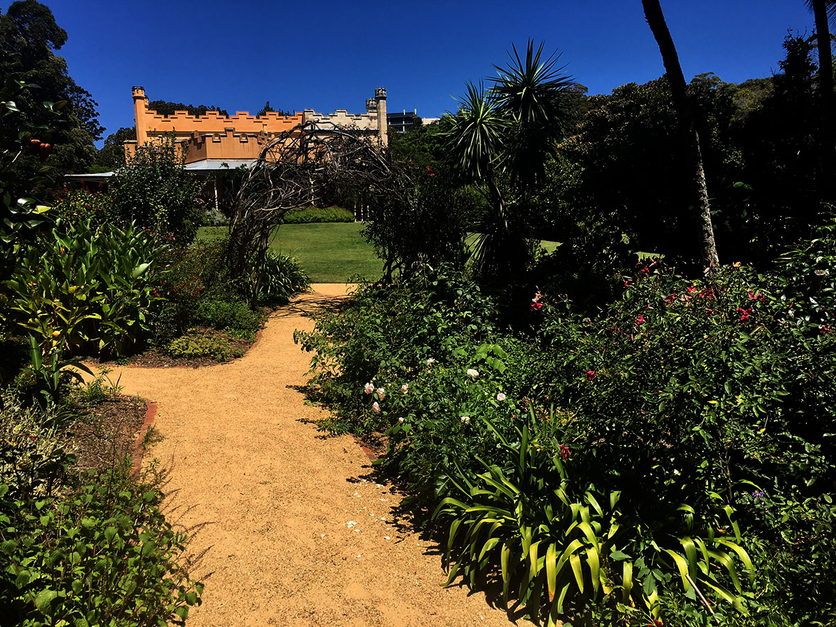 View of Vaucluse House from the Garden of Pleasure looking through an archway