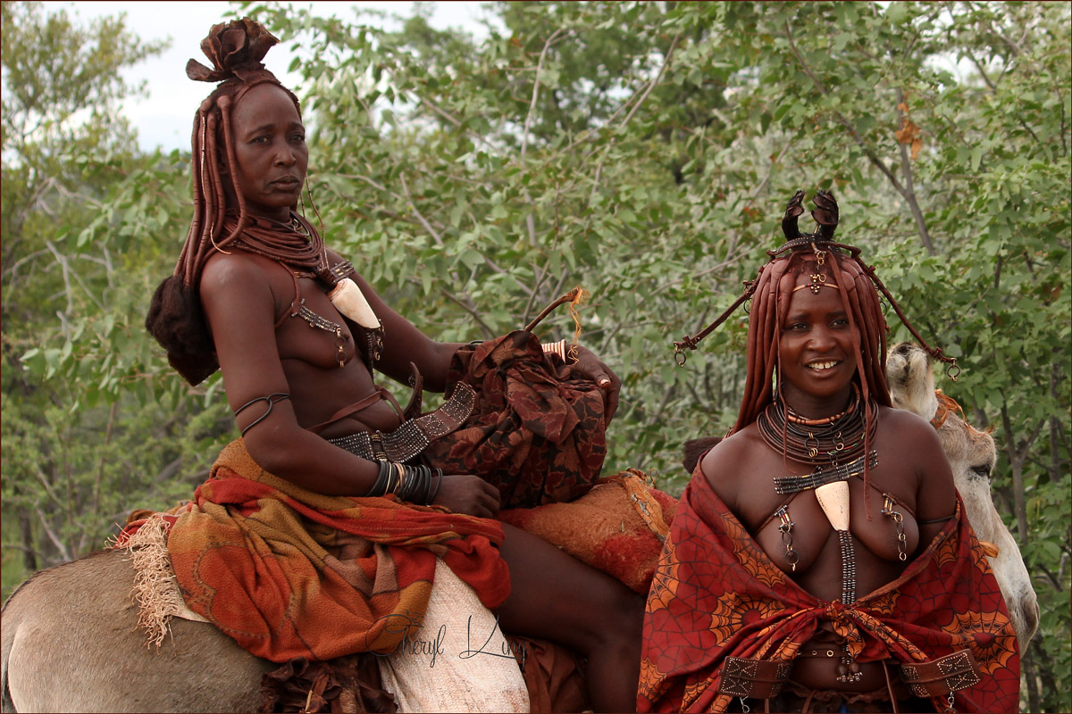 Married Himba women showing off their hairstyles and ornate jewellery.