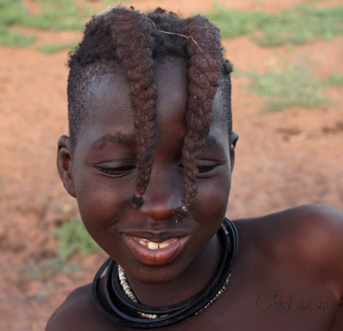 Young Himba girl with two plaits parrallel with her eyes