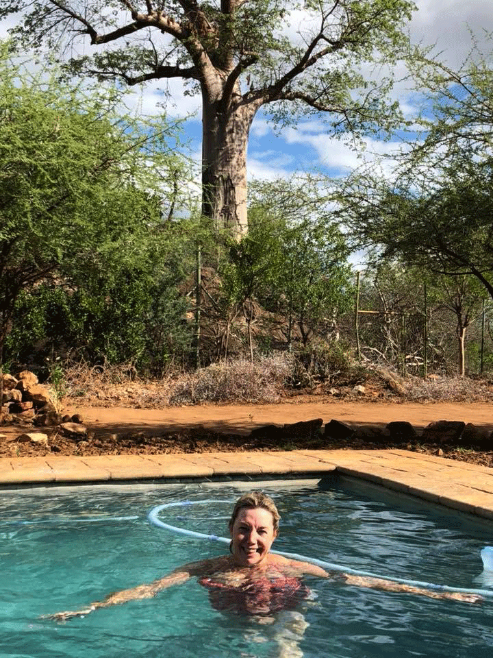 Writer in pool with Boabab in the background